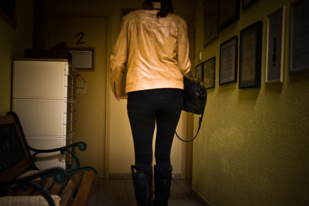 A Young Patient In A Hallway Of The Clinic